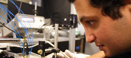 close up of male student working in lab