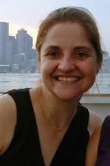 photo of Kristy Wood smiling with New York City in background