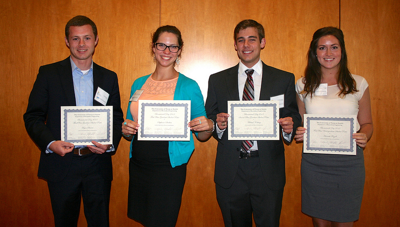 photo of four students holding awards